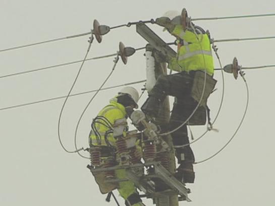 Men Working on Power Line